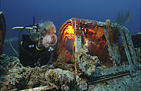 Asia, Republic of Palau, diver at the Jake Japanese Zero fighter, Short Drop Off  airplane wreck, Airplane, underwater, blue water, background, Zero fighter,  Japanese, airplane, aircraft, plane, aero plane, diver behind the wreck, shining wreck, light at