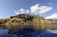 Asia, Indonesia, Komodo Island, clouds above the Island, blue water, calm, tranquil, quiet lagoon