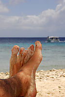 America, Carribean, Curacao, Netherlands Antilles, Dutch, Beach, feet in the sand, sand on the legs, Sandbeach, sandy, solitary, lonely, secret, tree, boat at the sea, ocean, holiday, vacation, recovering, relaxation, recreation