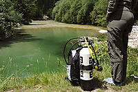Europe, Slovenia, preparation of the diving equipment, tank and regulator in front of the river Save, Savica