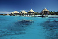 Oceania, French Polynesia, Tuamotus, South Sea Islands, South Pacific, Manihi, Overwater Bungalows in a Lagoon