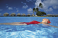 Oceania, French Polynesia, Tuamotus, South Sea Islands, South Pacific, Manihi, girl is relaxing in the pool, holiday feeling