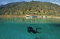Europe, Austria, Tyrol, Lake Lechau, diver with a boat above, freshwater, fresh water, coldwater, splitimages, split images