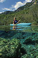 Europe, Italy, Friuli, kayak, kayaker in a freshwater lake, fresh water, coldwater, Riserva Naturale Lago di Cornino, Forgaria, algea, algas, splitimages, split images