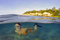 Asia, Indonesia, West Papua, Raja Ampat, Papua Paradise Eco Resort, Split image, overwater bungalows, snorkeling lady, girl under water
