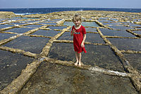 Europe, Malta, Gozo, Mediterranean Sea, ally commonwealth, little girl at the Limestone Bay, salt