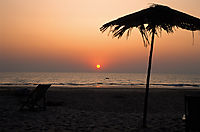 Asia, India, sunset at the beach of Goa, umbrella, evening light