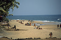 Asia, India, fisher, tourists at the sandy beach of Anjuna