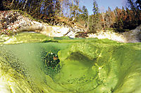 Europe; Austria; Upper Austria; Lake Attersee; Weissenbach; river diving; diving in river pools, coldwaterdiving, splitimage